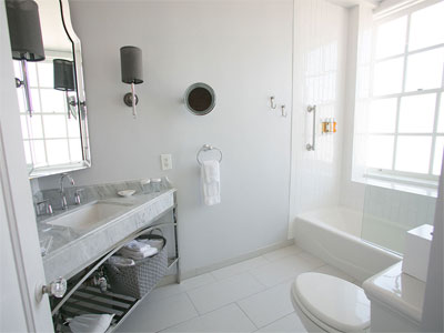 White Bathroom Reflects More Light And Can Make Small Look Larger